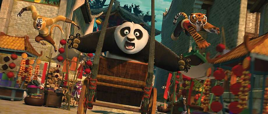 Po (Jack Black, center), Tigress (Angelina Jolie, right) and Monkey (Jackie Chan, left) are back in action chasing a runaway rickshaw in DreamWorks Animation's KUNG FU PANDA 2 to be released by Paramount on Thursday, May 26, 2011. Photo: Courtesy Of DreamWorks Animation