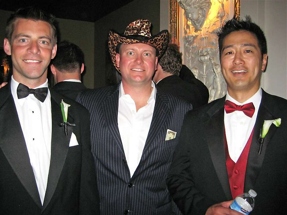 Neal Mueller (left) with Guardsmen President Marc Baluda and Larry Chiang at the Guardsmen Bachelor Auction. June 2011. By Catherine Bigelow. Photo: Catherine Bigelow, Special To The Chronicle