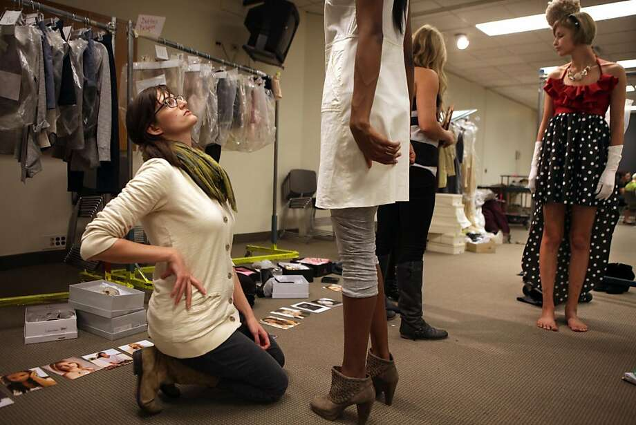 Leah Fagan, 25, left, in her first year with Chicago Fashion Incubator, fits a model in one of her outfits Thursday Oct 14, 2010. Designers with the Chicago fashion Incubator are preparing for their fashion show at Millennium Park and fitting models in their clothes at Macy's on State Street. Photo: Nancy Stone, Chicago Tribune