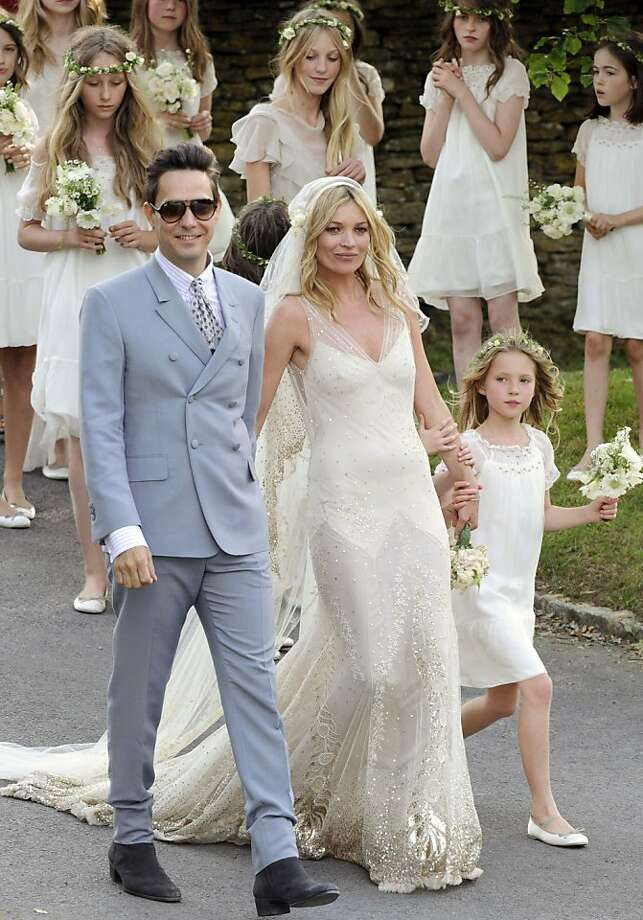 British model Kate Moss and British guitarist Jamie Hince pose for photographers with unidentified bridesmaids, after their wedding in the village of Southrop, England, Friday, July 1, 2011. Photo: Jonathan Short, AP