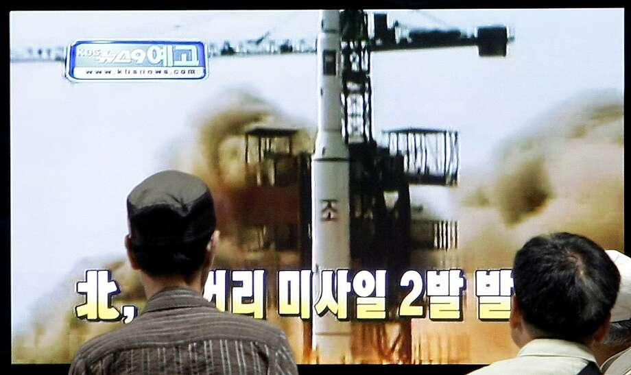 "South Koreans watch a television broadcasting undated image a North Korea launch missile at the Seoul Railway Station in Seoul, South Korea, Thursday, July 2, 2009. North Korea test-fired two short-range missiles Thursday, South Korea's Defense Ministry said, a move that aggravates already high tensions following Pyongyang's recent nuclear test and U.N. sanctions imposed as punishment. The Korean read ""North Korea test-fired two short-range missiles."" (AP Photo/ Lee Jin-man) Photo: Lee Jin-man, AP"