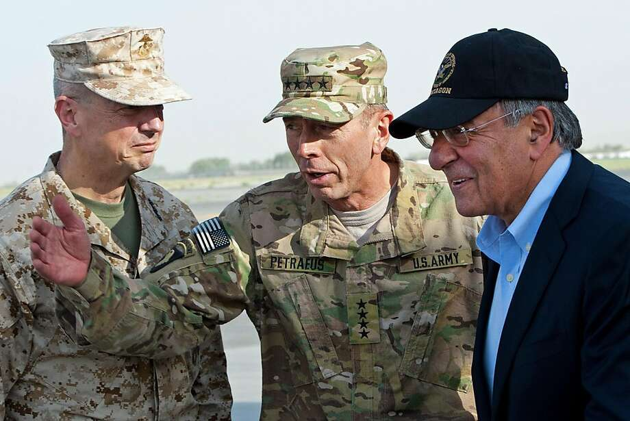US General John Allen (L) and General David Petraeus (C) greet US Secretary of Defense Leon Panetta as he lands in Kabul, Afghanistan, on July  9, 2011. Photo: Paul J. Richards, AFP/Getty Images