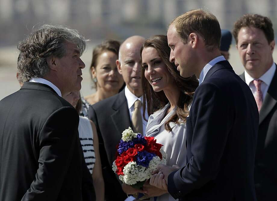 Prince William and Kate, the Duke and Duchess of Cambridge, talk to Canadian Consul General David Fransen, left, as they arrive at Los Angeles International Airport in Los Angeles, Friday, July 8, 2011. California Gov. Jerry Brown, background center, looks on. Photo: Jae C. Hong, AP