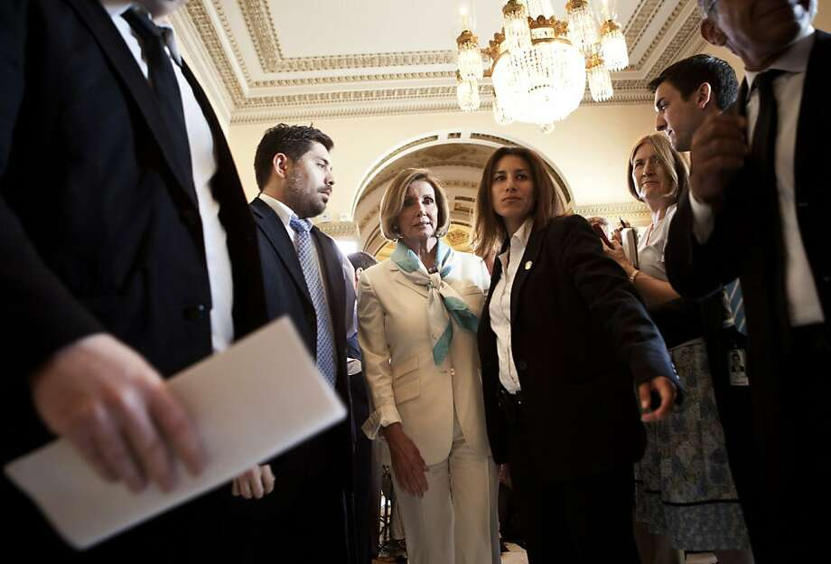 WASHINGTON - JULY 7:  House Minority Leader Nancy Pelosi (D-CA) (3rd L) leaves after speaking with reporters on Capitol Hill July 7, 2011 in Washington, DC.  Pelosi spoke to reporters about a meeting she attended with U.S. President Barack Obama and otherCongressional leaders about resolving the United State's debt crisis and the potential of the nation defaulting on its debt. Photo: Brendan Smialowski, Getty Images