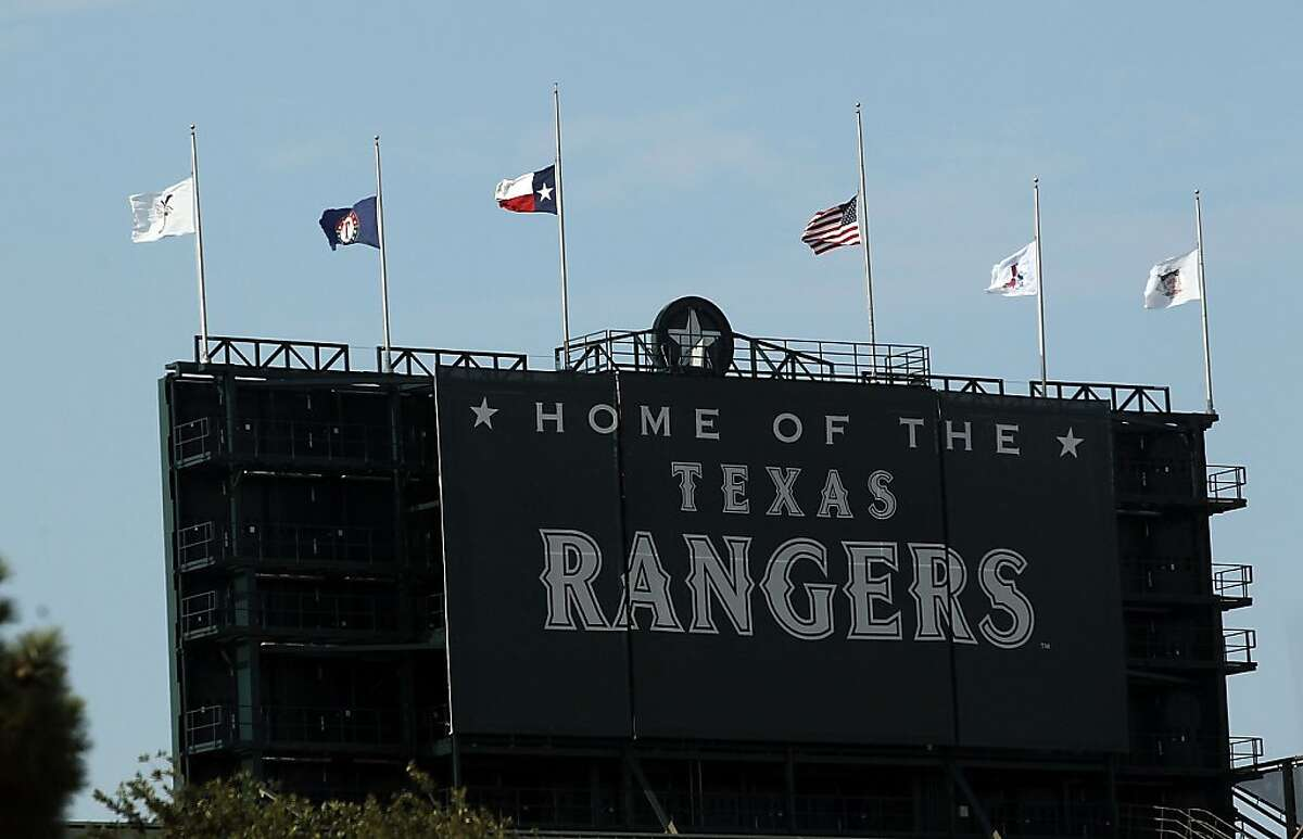 ARLINGTON, TX - JULY 08: Flags fly at half-mast for Shannon Stone, a fan who died after suffering a fall out of the stands at Rangers Ballpark in Arlington on July 8, 2011 in Arlington, Texas.