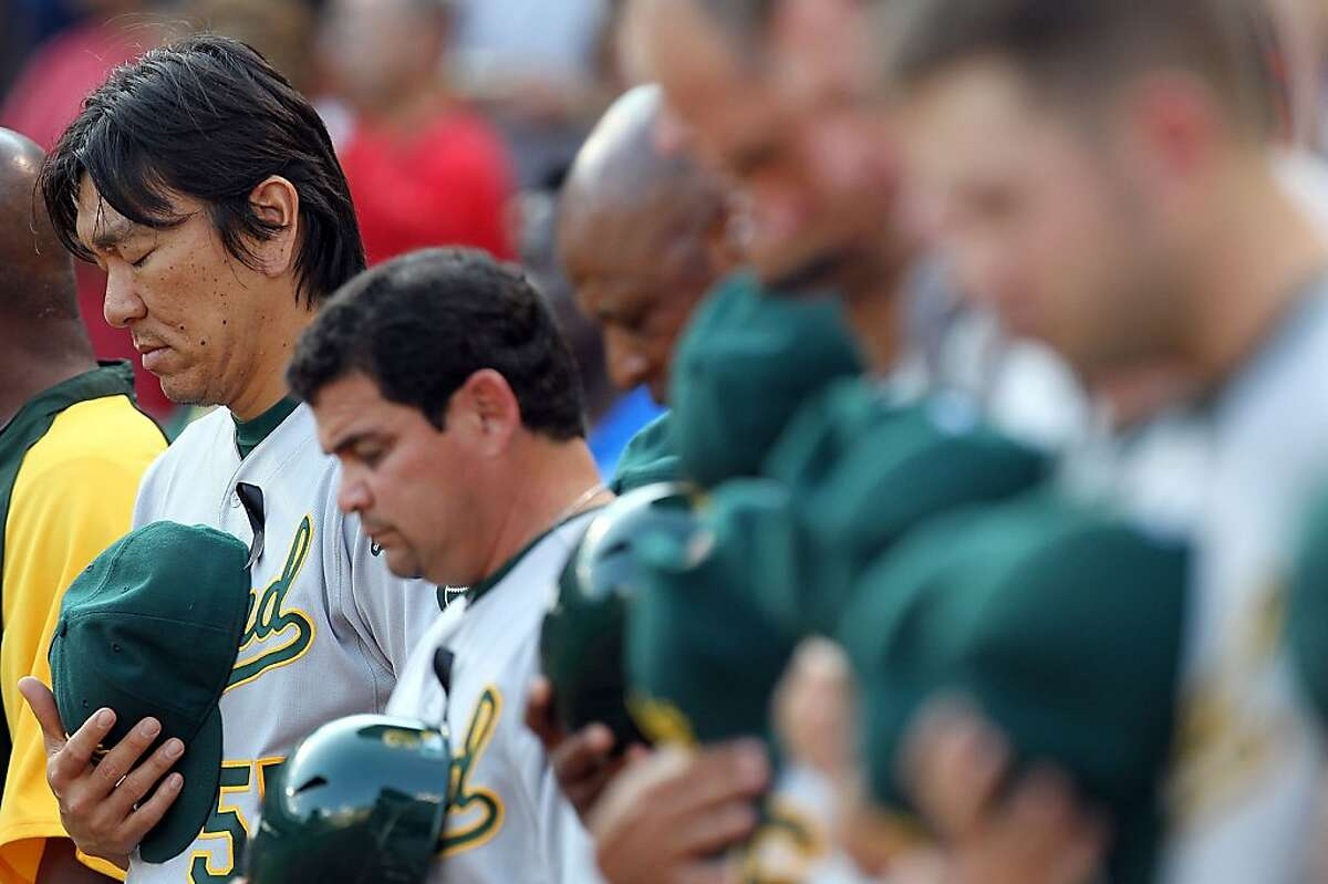 ARLINGTON, TX - JULY 08: Hideki Matsui #55 of the Oakland Athletics during a moment of silence for Shannon Stone, a fan who died after suffering a fall out of the stands at Rangers Ballpark in Arlington on July 8, 2011 in Arlington, Texas.