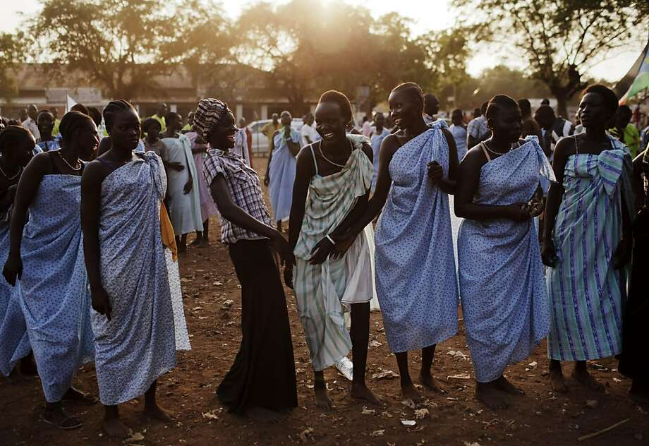 Women from the Bari community laugh after performing a traditional dance during celebrations on the eve of southern Sudan's declaration of independence in Juba, southern Sudan, Friday, July 8, 2011. Southern Sudan is set to declare independence from the north on Saturday. Photo: David Azia, AP