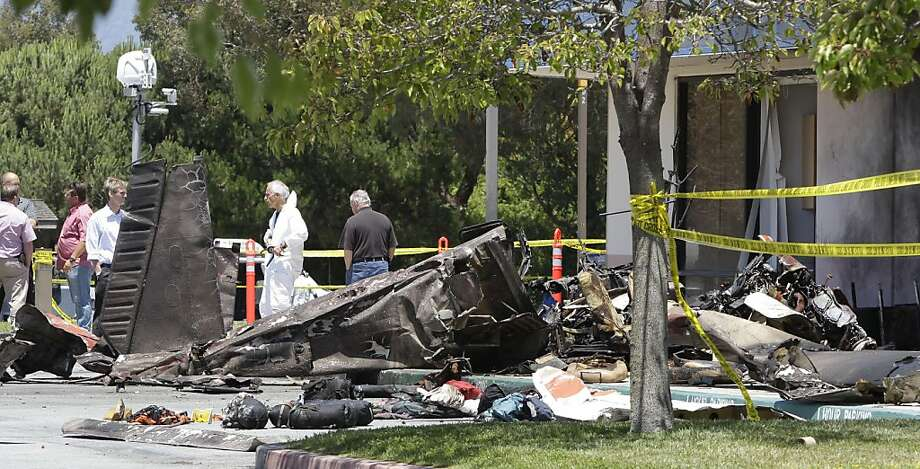 Officials look at a single engine plane crash at a hospital in Watsonville, Calif. on Friday, July 8, 2011 after it crashed on Thursday night. Federal investigators on Friday raised the death toll in a small plane crash, saying two adults and two childrenon the aircraft were killed. Photo: Paul Sakuma, AP