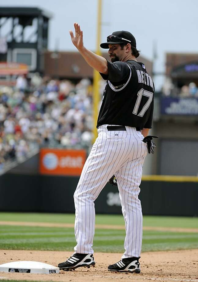 Colorado Rockies first baseman Todd Helton waves to the crowd as he is recognized for playing in his 2,000th career Major League Baseball game, during the sixth inning of an interleague game against the Chicago White Sox, Thursday, June 30, 2011, in Denver. Photo: Jack Dempsey, AP