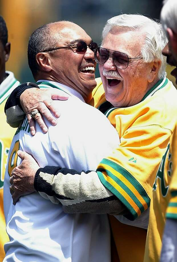 FILE - IN this May 22, 2004, file photo, Reggie Jackson, left, hugs former Oakland Athletics manager Dick Williams during a ceremony to retire Jackson's No. 9 with the Athletics in Oakland, Calif. Williams, who won two World Series titles with Oakland andled two other franchises to pennants, has died. He was 82. Williams died from a ruptured aortic aneurysm at a hospital near his home in Henderson, Nev., the Hall of Fame said Thursday, July 7, 2011. Photo: Jeff Chiu, AP