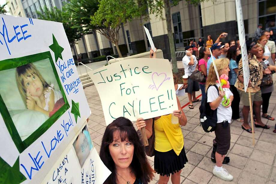 Lori Richards, of Daytona Beach, protests the Casey Anthony verdict outside of the Orange County Courthouse July 7, 2011 in Orlando, Florida. Anthony was acquitted of murder charges on July 5, 2011 but will serve four, one-year sentences on her conviction on July 7 of lying to a law enforcement officer. She will be credited for the nearly three-years of time served and good behavior and will reportedly be released July 13. Photo: Roberto Gonzalez, Getty Images