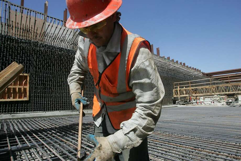 Jose Gonzalez prepares a field of rebar for a concrete pour on the Doyle Drive project. More than $1 billion in federal stimulus dollars that helped build and pave Bay Area roads, bridges and tunnels could go into reverse under a new plan by House Republicans who said they have little choice but to slash highway funding in an era of federal deficits. Photo: Mathew Sumner, Special To The Chronicle