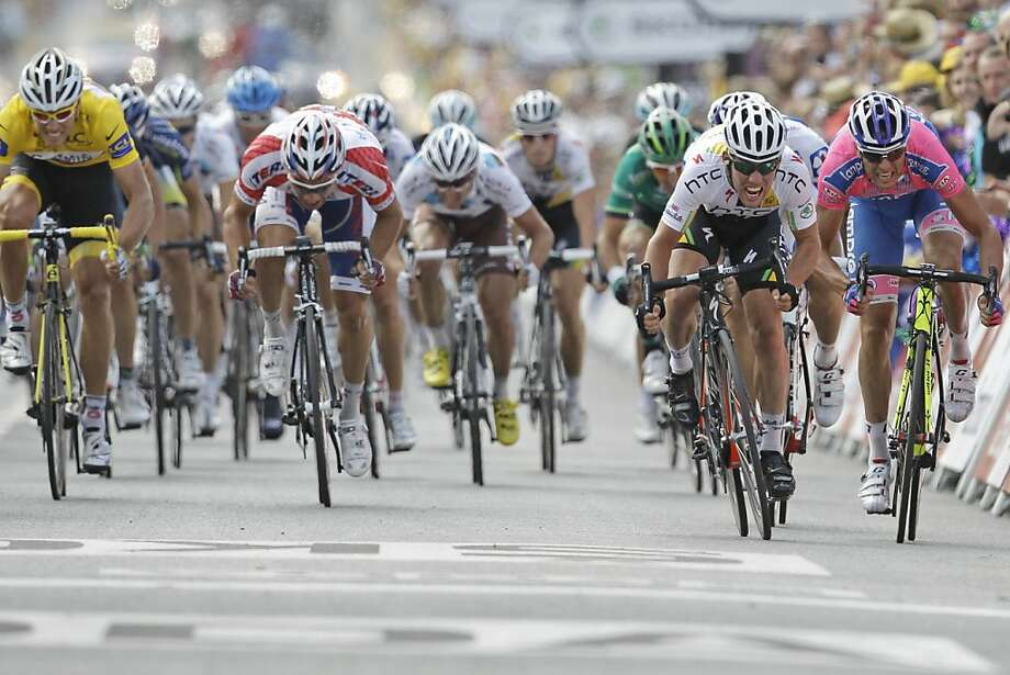 Mark Cavendish of Britain, second right,  sprints the finish line ahead of Alessandro Petacchi of Italy, far right and second place, to win the seventh stage of the Tour de France cycling race over 218 kilometers (135.5 miles) starting in Le Mans and finishing in Chateauroux, central France, Friday July 8, 2011. Photo: Laurent Cipriani, AP