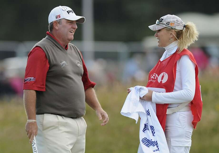 ST ANDREWS, SCOTLAND - JULY 17:  Mark Calcavecchia of the USA and his wife and caddie Brenda Calcavecchia during the third round of the 139th Open Championship on the Old Course, St Andrews on July 17, 2010 in St Andrews, Scotland.  (Photo by Harry How/Getty Images) Photo: Harry How, Getty Images