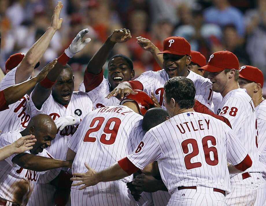 Philadelphia Phillies' Raul Ibanez, center, celebrates with teammates at home plate after hitting the game-winning home run off Atlanta Braves relief pitcher Scott Proctor in the 10th inning of a baseball game, Saturday, July 9, 2011, in Philadelphia. Philadelphia won 3-2 in 10 innings. Photo: Matt Slocum, AP