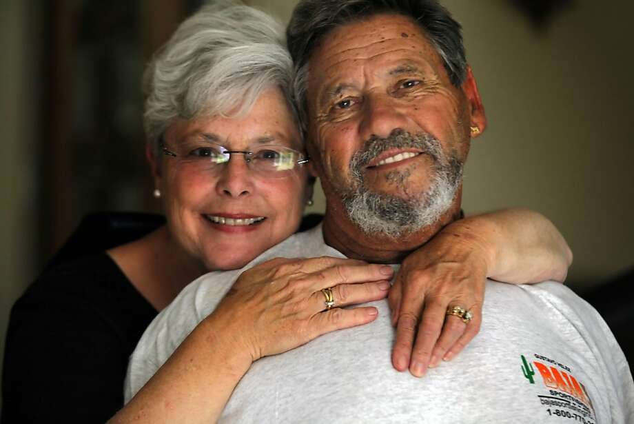 Pete Zuger from Novato gets a hug from his wife of 43 years Jackie after returning home from a fishing trip in Mexico that went horribly wrong Friday, July 8, 2011. Zuger feels lucky to be one of the first survivors rescued after his fourteen hour ordeal that had him for a time hanging onto an ice chest before he and a friend found a capsized boat that they could climb onto until rescued. Photo: Lance Iversen, The Chronicle