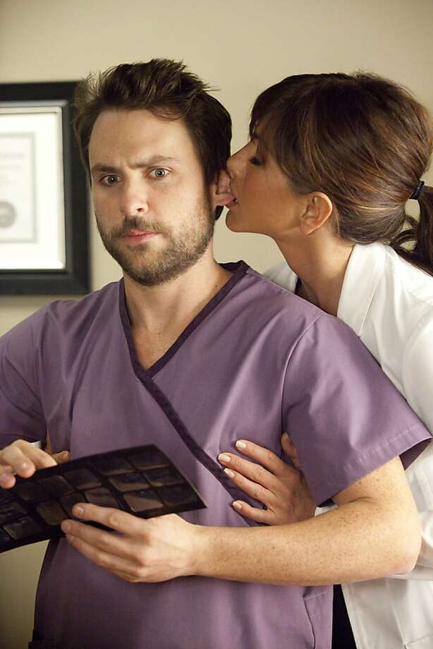(L-r) CHARLIE DAY as Dale and JENNIFER ANISTON as Dr. Julia Harris in New Line CinemaÕs comedy ÒHORRIBLE BOSSES,Ó a Warner Bros. Pictures release. Photo: John P. Johnson, Warner Bros.