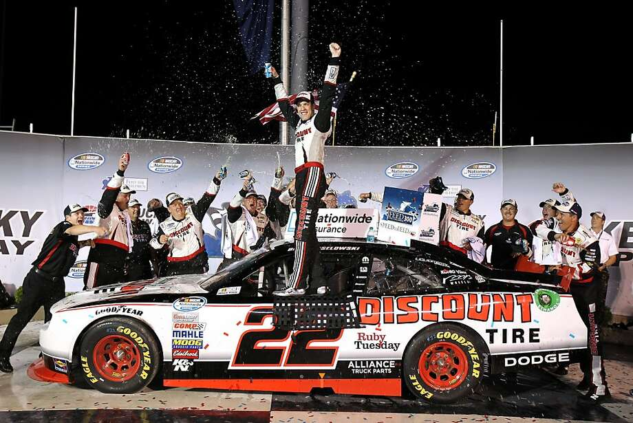 Brad Keselowski, driver of the #22 Discount Tire Dodge, celebrates in Victory Lane after winning the NASCAR Nationwide Series Feed the Children 300 at Kentucky Speedway on July 8, 2011 in Sparta, Kentucky. Photo: Tom Whitmore, Getty Images For NASCAR