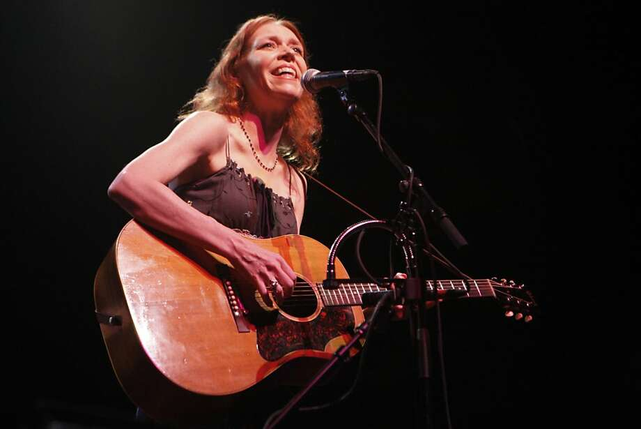 Gillian Welch sings and performs one of her songs Elvis Presley Blues with David Rawlings at the Warfield in San Francisco Calif.,  on July 7, 2011. Photo: Audrey Whitmeyer-Weathers, The Chronicle
