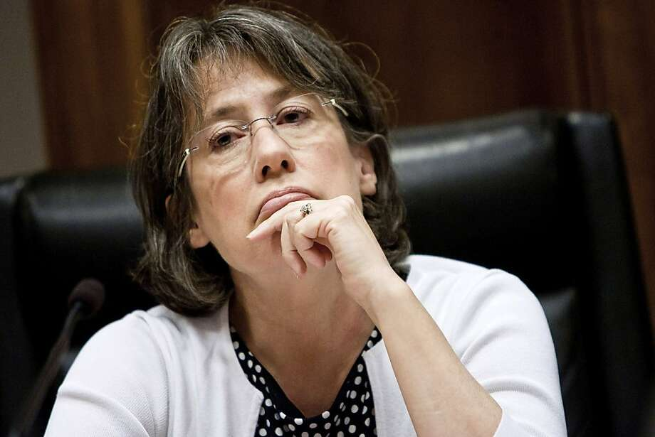 Sheila Bair, chairman of the U.S. Federal Deposit Insurance Corp. (FDIC), listens during an FDIC board meeting in Washington, D.C., U.S., on Wednesday, July 6, 2011. Regulators would be able to claw back some pay from top U.S. financial executives if their company were liquidated by the government, under a rule adopted by the FDIC. Photo: T.J. Kirkpatrick, Bloomberg