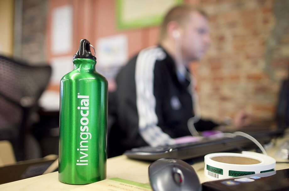 A LivingSocial water bottle sits on a desk at the company's headquarters in Washington, D.C., U.S., on Wednesday, Dec. 8, 2010. LivingSocial, the second-biggest website for daily deals, will use a $183 million investment led by Amazon.com Inc. to overtakemarket leader Groupon Inc., the company's chief executive officer said. Photographer: Andrew Harrer/Bloomberg Photo: Andrew Harrer, Bloomberg News
