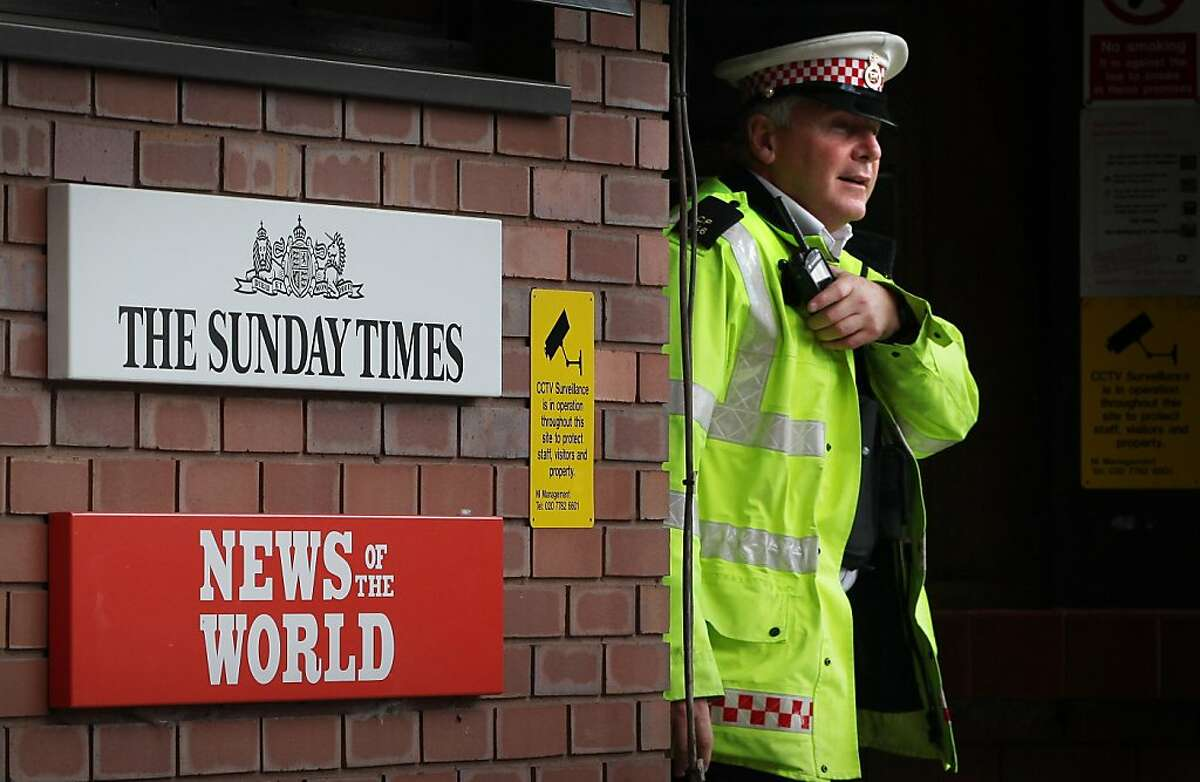 LONDON, ENGLAND - JULY 07: A policeman walks through the security gates at News International's Wapping plant on July 7, 2011 in London, England. Following further serious allegations that phone hacking was widespread at the News of the World newspaper,Chief Executive James Murdoch has announced the newspaper will close.