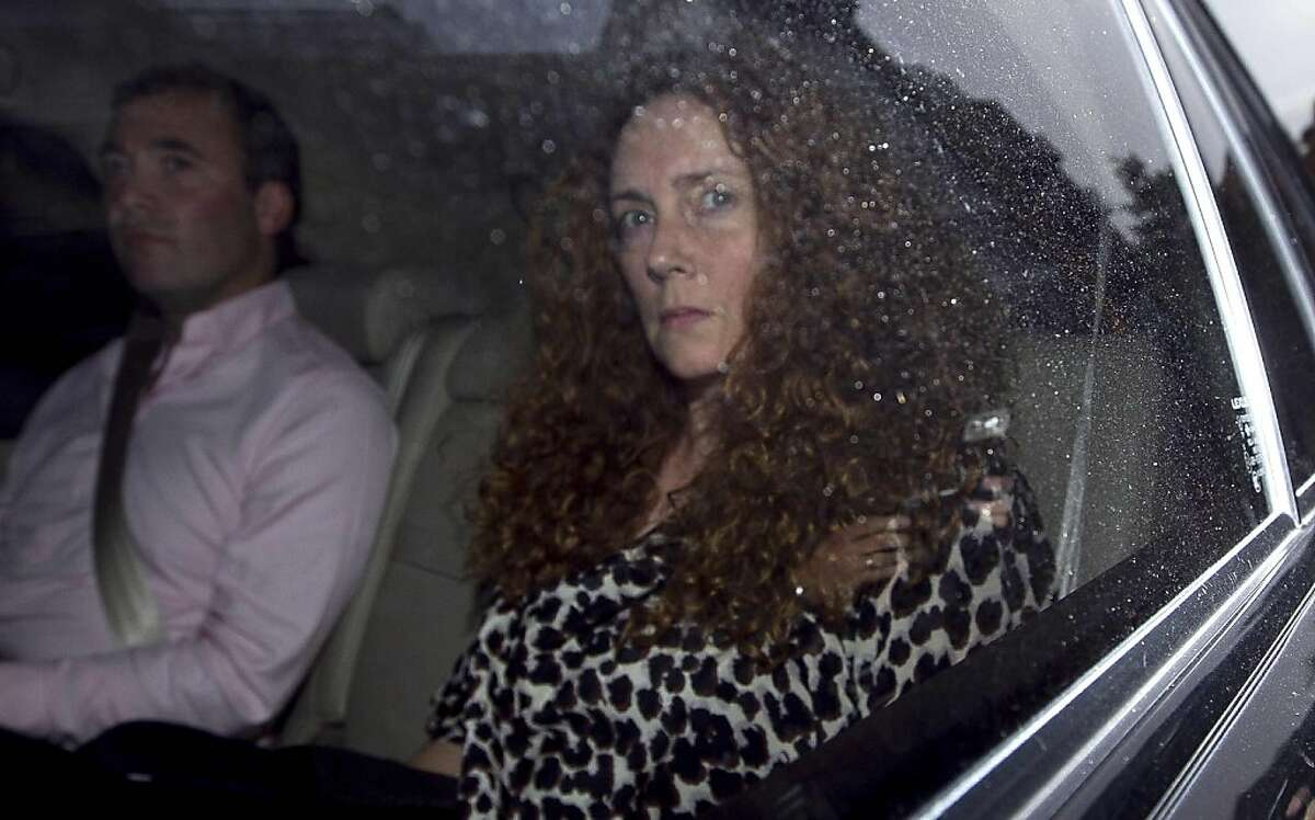 Rebekah Brooks, chief executive of News International is driven away from offices of News International in London, Thursday, July 7, 2011. News International announced Thursday it is shutting down the News of the World, the best-selling Sunday tabloid atthe center of Britain's phone hacking scandal. James Murdoch, who heads European operations for the paper's parent company, said the 168-year-old weekly newspaper would publish its last edition Sunday. The scandal has cost the Sunday-only paper prestigeand prompted dozens of companies to pull their ads.