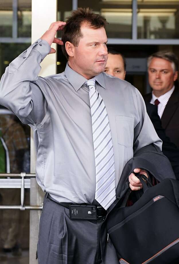 Former Major League Baseball pitcher Roger Clemens exits the federal court in Washington, Wednesday, July 6, 2011, where he is on trial on charges of lying to Congress in 2008 when he denied ever using performance-enhancing drugs during his 23-year career. Photo: Cliff Owen, AP