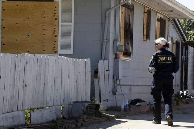 An Alameda County Sheriff Deputy walks up the driveway to the boarded up home of Phillip and Nancy Garrido's outside of Antioch Wednesday Sept 16, 2009. Investigators are back at the Northern California home of a couple already charged with one child abduction seeking any evidence that might link them to two other cases in the 1980s. Photo: Lance Iversen, The Chronicle