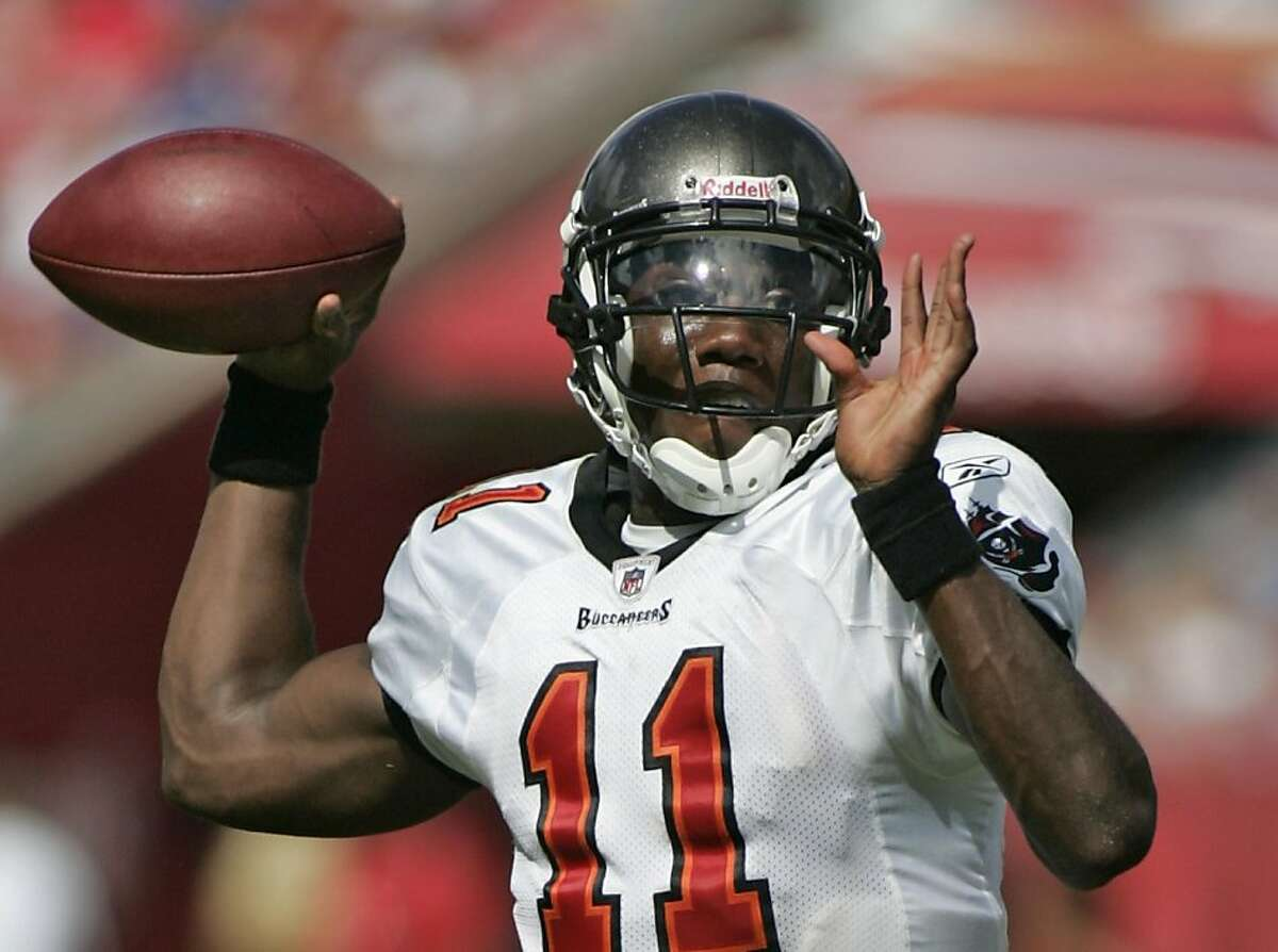 Tampa Bay Buccaneers quarterback Josh Johnson (11) drops to throw during the fourth quarter of an NFL football game against the New York Giants in Tampa, Fla. on Sunday, Sept. 27, 2009. The Giants won 24-0. (AP Photo/Reinhold Matay)