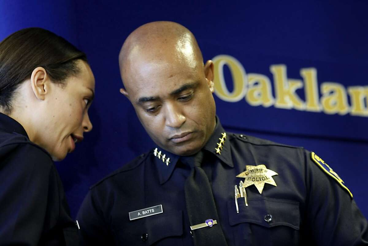 Police Chief Anthony Batts (right) listened to officer Holly Joshi during the press conference. Oakland Police Chief Anthony Batts announced a major reorganization of his department Wednesday July 6, 2011 that would involve making officers less specialized and more involved with the investigative process.