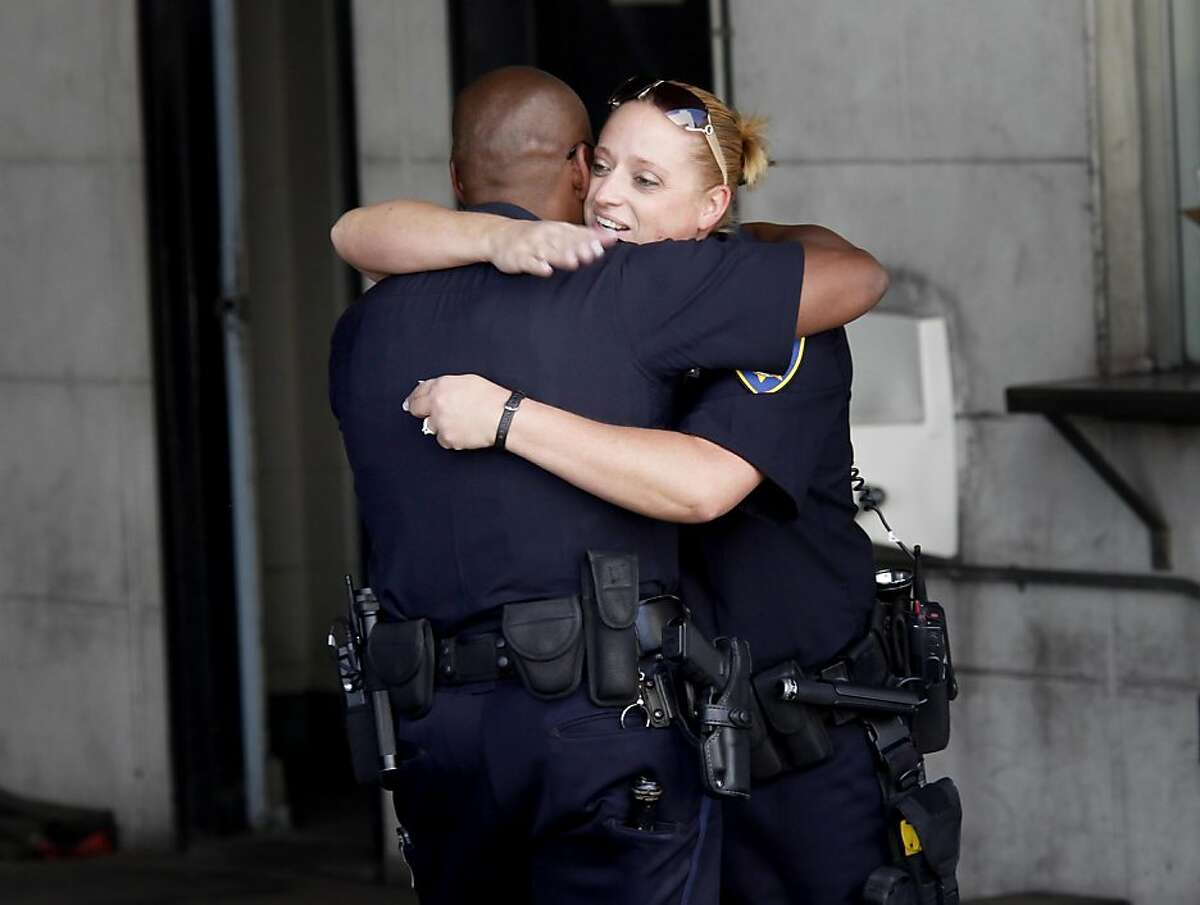 Police officer Wendy Nash hugged fellow officer Torrey Nash near police headquarters. Oakland Police Chief Anthony Batts announced a major reorganization of his department Wednesday July 6, 2011 that would involve making officers less specialized and more involved with the investigative process.