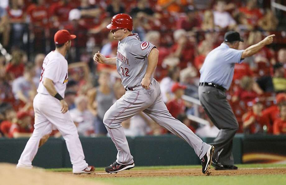 The Cincinnati Reds' Jay Bruce rounds third base and scores the game-winning run on a ground-rule double by Ramon Hernandez in the 13th inning as third base umpire Dale Scott signals the hit fair during action against the St. Louis Cardinals at Busch Stadium in St. Louis, Missouri, on Wednesday, July 6, 2011. (Chris Lee/St. Louis Post-Dispatch/MCT) Photo: Chris Lee, MCT