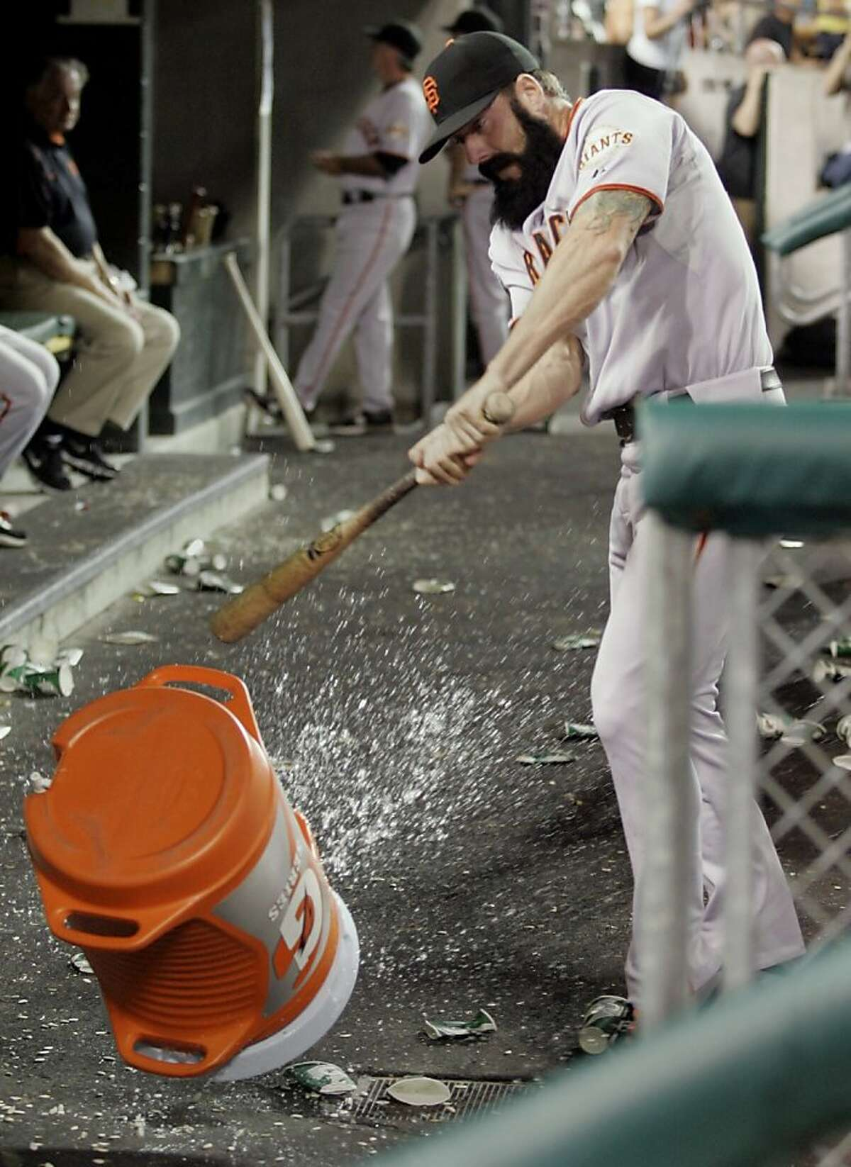 San Francisco Giants reliever Brian Wilson takes a bat to a water cooler after being pulled from a interleague baseball game against the Detroit Tigers in the ninth inning Friday, July 1, 2011 in Detroit. Wilson was pulled after giving up a RBI-single toDetroit's Brandon Inge. The Giants defeated the Tigers 4-3.