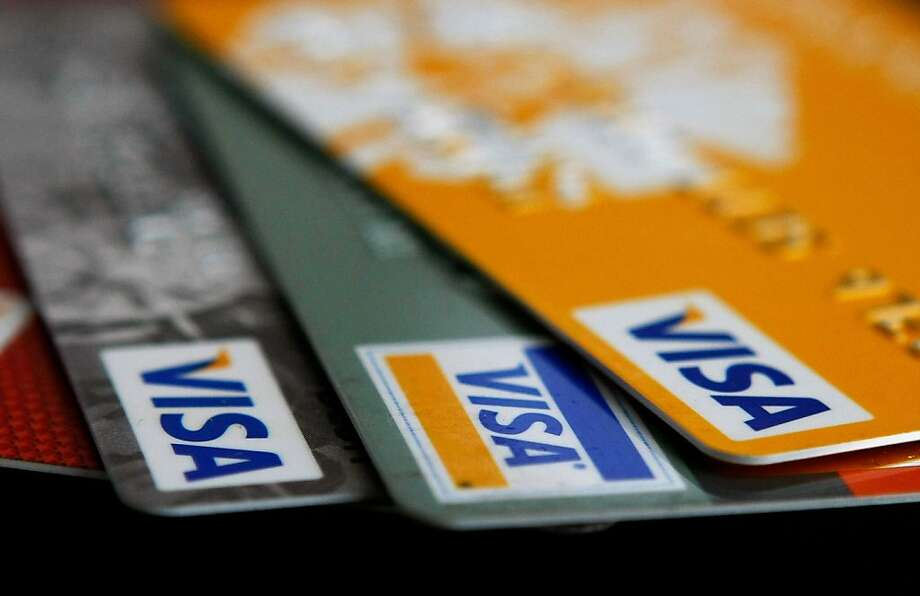 SAN FRANCISCO - FEBRUARY 25:  Visa credit cards are arranged on a desk February 25, 2008 in San Francisco, California. Visa Inc. is hoping that its initial public offering could raise up to $19 billion and becoming  the largest IPO in U.S. history.  (Photo Illustration by Justin Sullivan/Getty Images) Photo: Justin Sullivan, Getty Images