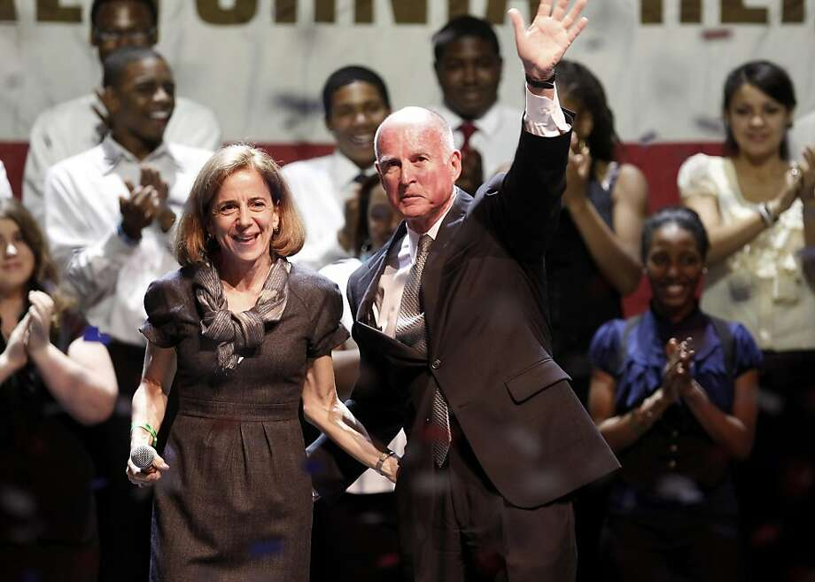Jerry Brown and his wife Anne Gust waved to supporters after his speech with members of the Oakland School for the Arts in the background. Governor-elect Jerry Brown addressed supporters at the Fox Theatre in downtown Oakland, Calif. Tuesday November 2, 2010. Photo: Brant Ward, The Chronicle