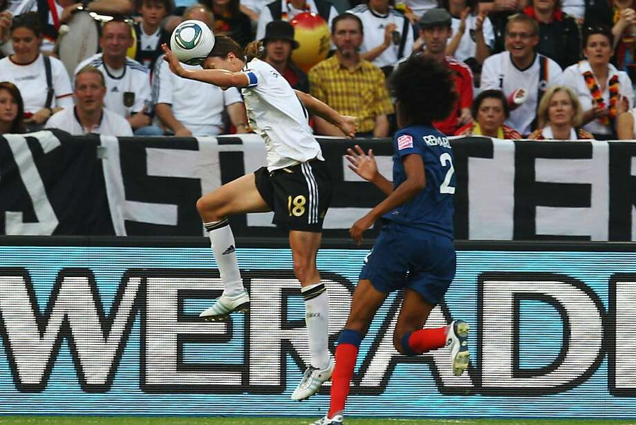 MOENCHENGLADBACH, GERMANY - JULY 05:  Kerstin Garefrekes of Germany scores her team's first goal against Wendie Renard of France during the FIFA Women's World Cup 2011 Group A match between France and Germany at the Fifa Womens World Cup Stadium on July 5, 2011 in Moenchengladbach, Germany. Photo: Alex Grimm, Getty Images