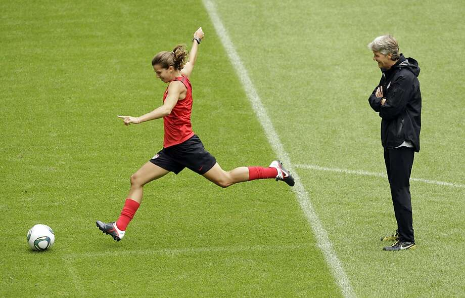 United States head coach Pia Sundhage, at right, watches as Tobin Heath takes a shot on goal during a training session in preparation for a match against Sweden during the Women's Soccer World Cup in Wolfsburg, Germany, Tuesday, July 5, 2011. Photo: Marcio Jose Sanchez, AP