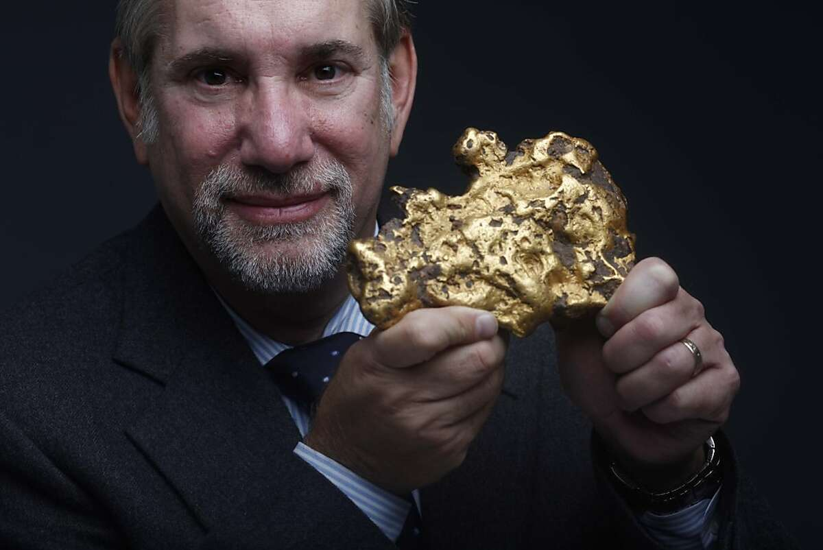 Don Kagin holds a 98.6 ounce gold nugget in the Chroniicle studio on Friday January 14, 2011 in San Francisco, Calif. He and his business partner Fred Holabird are auctioning off the nugget in Sacramento on Wednesday March 16, 2011.