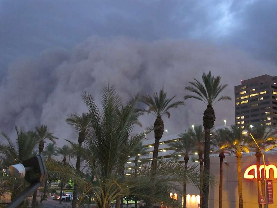 """A dust storm known as a """"haboob"""" rolls into downtown Phoenix on Tuesday night, July 5, 2011, bringing strong winds and low visibility. Haboobs are part of Arizona's annual monsoon season, which is now in full swing. Photo: Amanda Lee, AP"""