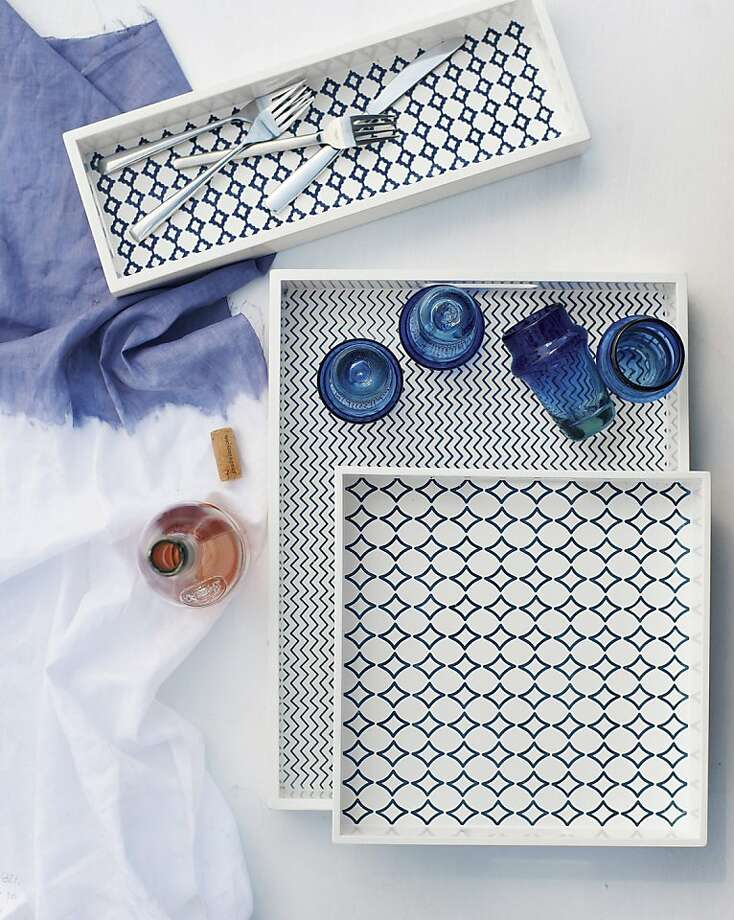 This product image courtesy of West Elm shows Mediterranean tilework-patterned lacquered trays from David Stark's collection. In his summer collection for West Elm, Stark has returned to his roots as a painter. Photo: AP