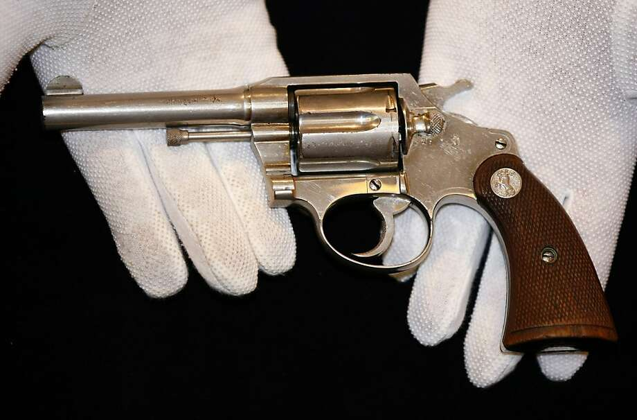 """A handgun once owned by notorious gangster """"Al"""" Capone, is displayed at Christie's auction house, London, Tuesday, June 21, 2011. The Colt .38 revolver will be going up for auction this week, and is expected to sell for between 50,000 pounds ($80,899/56,650 euro) and 70,000 pounds ($113,258/79,315 euro). Photo: Tim Hales, AP"""