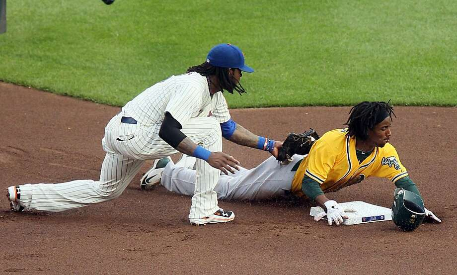 Jemile Weeks #19 of the Oakland Athletics steals second base in the first inning ahead of the tag from Jose Reyes #7 of the New York Mets at Citi Field on June 21, 2011 in the Flushing neighborhood of the Queens borough of New York City. Photo: Jim McIsaac, Getty Images