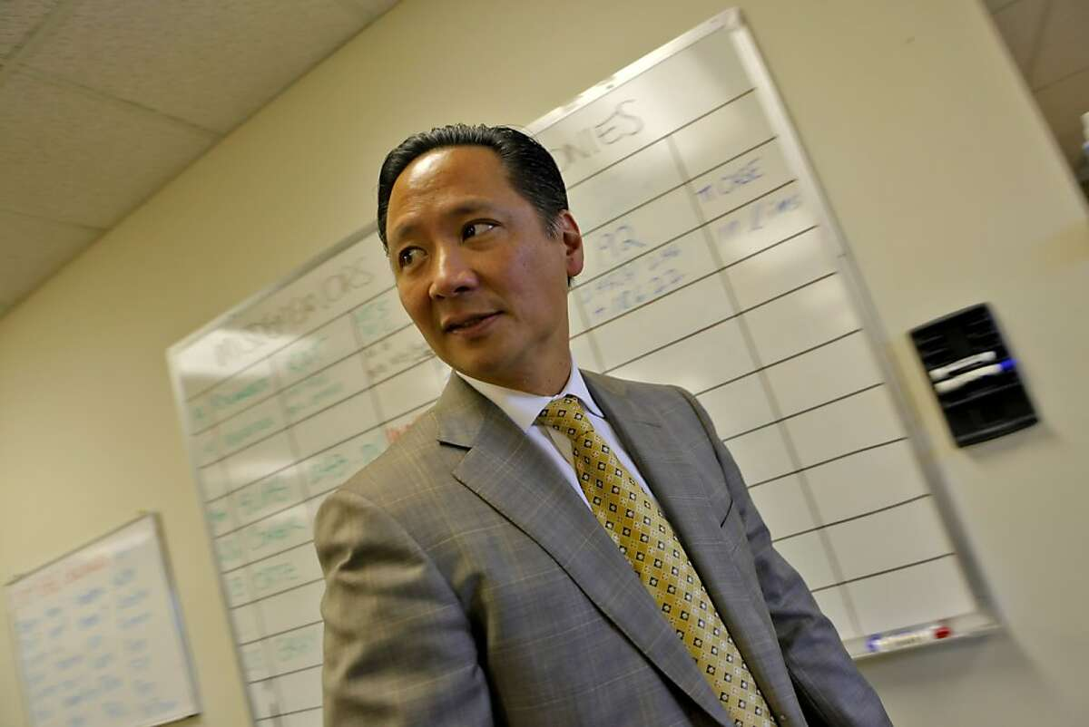 San Francisco Public Defender Jeff Adachi walks through his office where the board of misdemeanors and felonies hangs for his staff, Tuesday Sept. 29, 2010, in San Francisco, Calif.