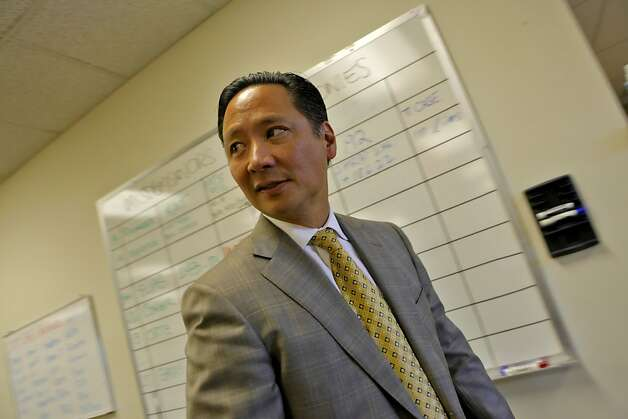 San Francisco Public Defender Jeff Adachi walks through his office where the board of misdemeanors and felonies hangs for his staff,   Tuesday Sept. 29, 2010, in San Francisco, Calif. Photo: Lacy Atkins, The Chronicle