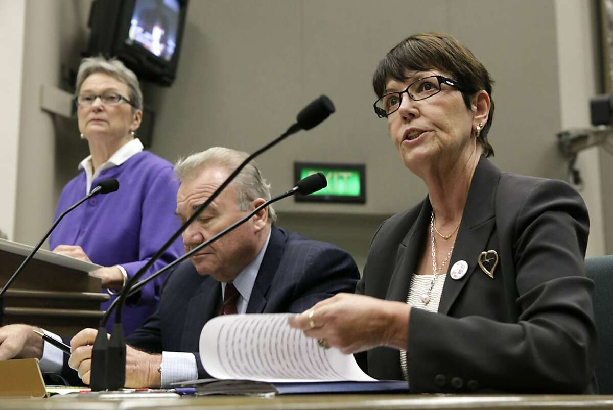 Former San Quentin State Prison Warden Jeanne Woodford, right, who presided over several executions speaks in support of a measure by State Sen. Loni Hancock, D-Berkeley, left, to abolish capital punishment at a hearing of the Assembly Public Safety Committee at the Capitol in Sacramento, Calif., Thursday, July 7, 2011. The committee voted 5-2 along party lines in favor of the measure that if signed into law would put the question before voters in 2012. In the center is attorney Don Heller, a former prosecutor who wrote the proposition approved by voters in 1978 that restored the death penalty who also supports Hancock's measure. (AP Photo/Rich Pedroncelli)Je