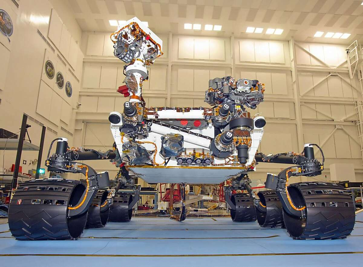 Taken during mobility testing on June 3, 2011, this image is of the Mars Science Laboratory rover, Curiosity, inside the Spacecraft Assembly Facility at NASA's Jet Propulsion Laboratory, Pasadena, California. Preparations continue for shipping the rover to NASA's Kennedy Space Center in Florida in June and for its fall 2011 launch. (NASA/JPL-Caltech/MCT)