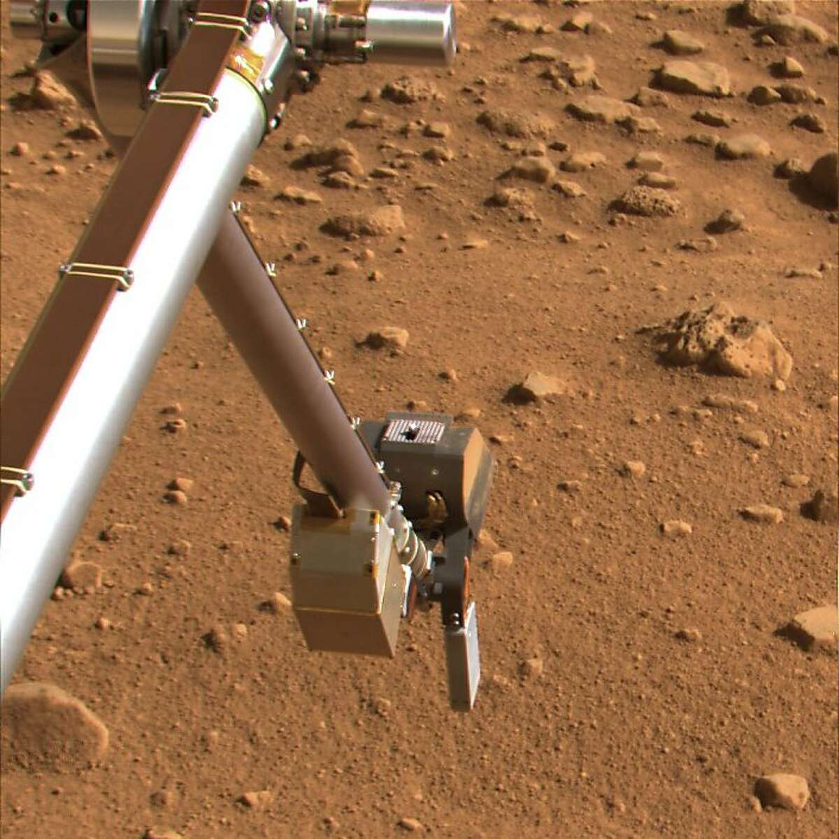 This undated image provided by NASA shows the Phoenix spacecraft's inverted scoop preparing to take soil samples on Mars. NASA's Phoenix spacecraft has detected the presence of a chemically reactive salt in the Martian soil, a finding that if confirmed could make it less friendly to potential life than once believed, according to a report Monday Aug. 4, 2008. (AP Photo/NASA)