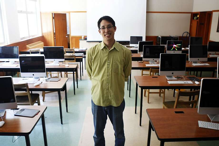 Graphic novelist Gene Yang stands in a classroom at Bishop O'Dowd High School in Oakland, Calif., where he teaches computer science on Thursday, June 30.  His graphic novels mostly deals with Asian-American identity and in 2006 he was nominated for a National Book Award. His latest book, Level Up, deals with a video-game obsessed kid who feels pressured by his father's desire for him to become a doctor. Photo: Maddie McGarvey, The Chronicle