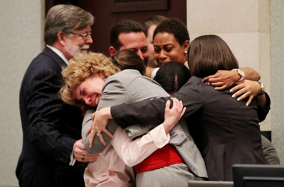 ORLANDO, FL - JULY 5:  Defense attorney Dorothy Clay Sims, in gray jacket, hugs her client Casey Anthony, along with the rest of the defense team after Anthony was acquitted of murder charges at the Orange County Courthouse on July 5, 2011 in Orlando, Florida. Casey Anthony had been accused of murdering her two-year-old daughter Caylee in 2008 and was found not guilty of manslaughter in the first degree. Photo: Pool, Getty Images